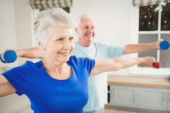 Senior couple performing stretching exercise Royalty Free Stock Photo