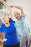 Senior couple performing stretching exercise Stock Image