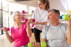 Senior couple with a personal trainer Royalty Free Stock Images