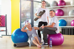Senior couple with a personal trainer Royalty Free Stock Photos
