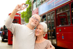 Senior couple photographing on london city street royalty free stock image