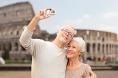 Senior couple photographing over coliseum Royalty Free Stock Images