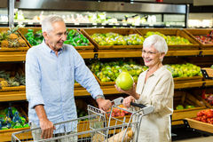 Senior couple picking out fruit Stock Images