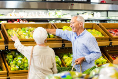 Senior couple picking out fruits together Royalty Free Stock Photo