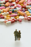 Senior couple with pills Royalty Free Stock Photo