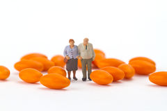 Senior Couple with pills Royalty Free Stock Images