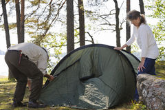 Senior couple pitch a tent royalty free stock photography