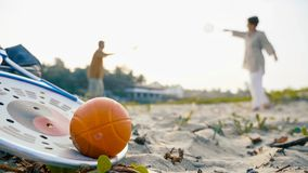 A senior couple plaing tai chi ball game with racket and ball on the foreground royalty free stock photography