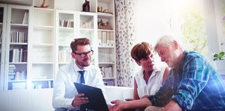 Senior couple planning their investments with financial advisor stock photos