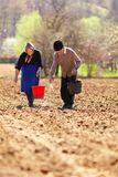 Senior couple planting on their land Royalty Free Stock Photos
