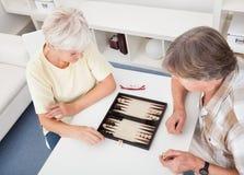 Senior Couple Playing Backgammon Royalty Free Stock Photo