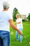 Senior Couple Playing Badminton Royalty Free Stock Images