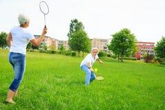 Senior Couple Playing Badminton Royalty Free Stock Photo