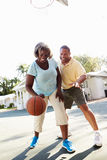 Senior Couple Playing Basketball Together Stock Photography