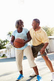 Senior Couple Playing Basketball Together Royalty Free Stock Photography