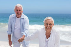 Senior couple playing at the beach Stock Image