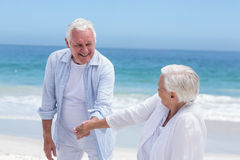 Senior couple playing at the beach Stock Photography