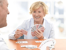 Senior Couple Playing a Card Game royalty free stock image