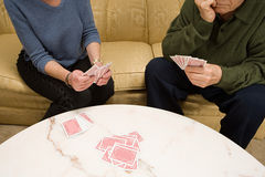 Senior couple playing cards Stock Images