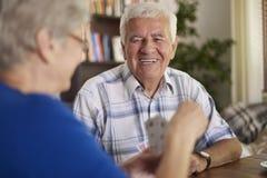 Senior couple playing cards Stock Photos
