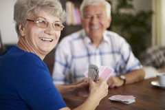 Senior couple playing cards Stock Photos
