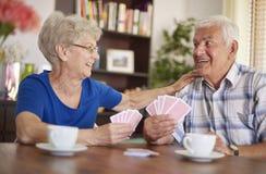 Senior couple playing cards Stock Photo
