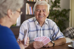 Senior couple playing cards Royalty Free Stock Photo