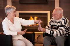 Senior couple playing cards on winter night Royalty Free Stock Photography