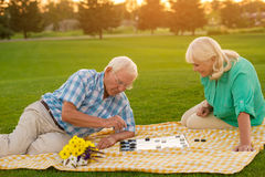 Senior couple playing checkers. Royalty Free Stock Images