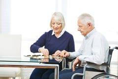 Senior couple playing checkers Royalty Free Stock Photo