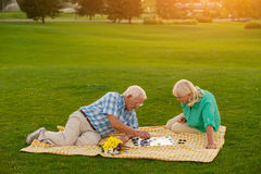 Senior couple is playing checkers. Stock Image