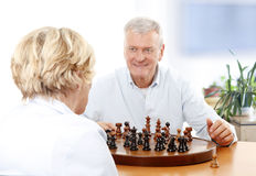 Senior couple playing chess Stock Photo
