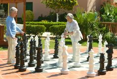 Senior couple playing chess Stock Photos