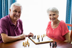 Senior couple playing chess Stock Photos