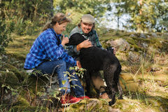 Senior couple playing with a dog Royalty Free Stock Images