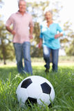 Senior couple playing football Royalty Free Stock Photos