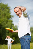 Senior couple playing frisbee in nature Stock Photography
