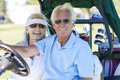 Senior Couple Playing Golf Driving Cart Buggy Stock Image