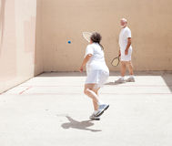 Senior Couple Playing Racquetball royalty free stock photography