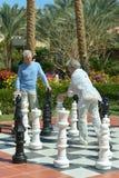 Senior couple playing street chess Stock Photos