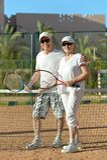 Senior couple playing tennis Stock Photos