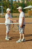 Senior couple playing tennis Stock Photography