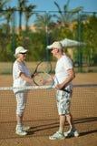 Senior couple playing tennis Royalty Free Stock Photos