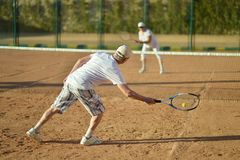 Senior couple playing tennis Stock Images