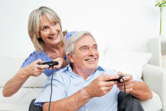 Senior couple playing video games stock photo