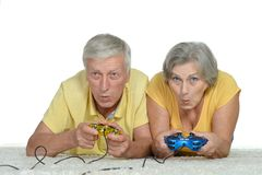 Senior Couple Plays Video Game Royalty Free Stock Images