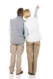 Senior couple pointing Royalty Free Stock Photos