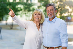 Senior couple pointing Stock Images