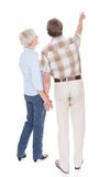 Senior couple pointing Royalty Free Stock Photo