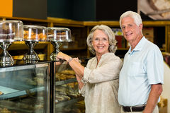 Senior couple pointing puddings Stock Image